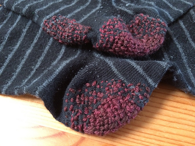 close-up of the heels of a pair of darned socks
